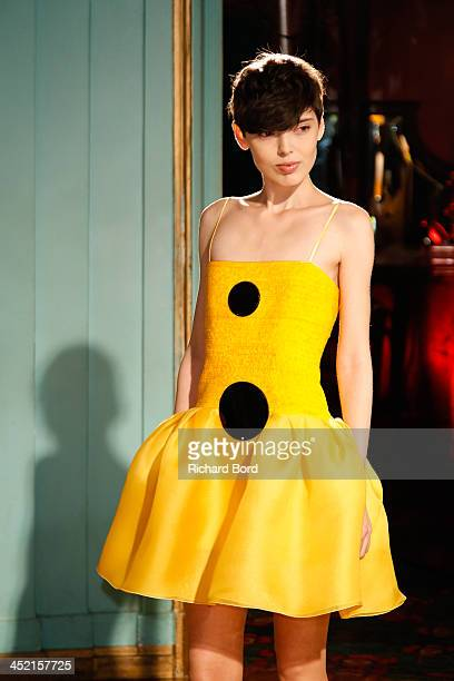 A model walks the runway during the Pierre Cardin Paris Haute Couture New Collection launch at Maxim's on November 26 2013 in Paris France