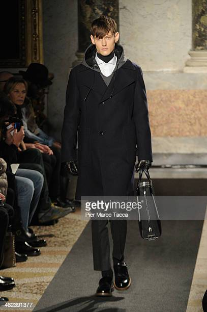 A model walks the runway during the Ports 1961 show as a part of Milan Fashion Week Menswear Autumn/Winter 2014 on January 13 2014 in Milan Italy