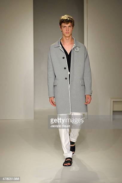 A model walks the runway during the Pringle of Scotland fashion show as part of Milan Men's Fashion Week Spring/Summer 2016 on June 21 2015 in Milan...