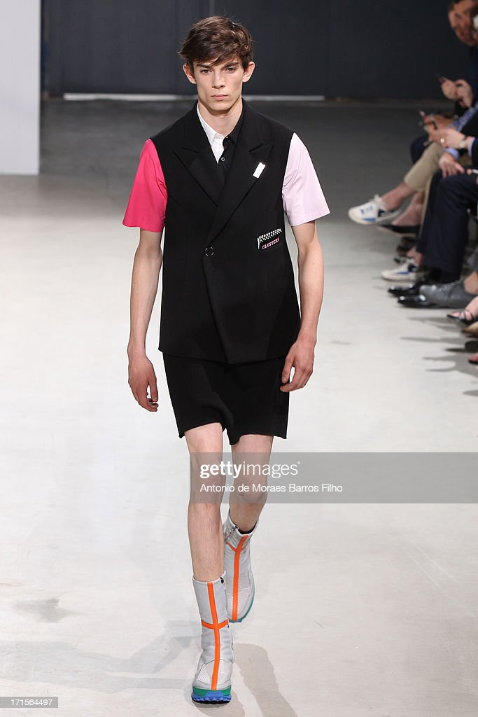A model walks the runway during the Raf Simons Menswear Spring/Summer 2014 Show As Part Of The Paris Fashion Week on June 26, 2013 in Paris, France.