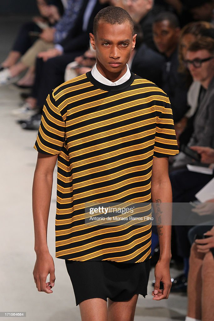A model walks the runway during the Raf Simons Menswear Spring/Summer 2014 Show as part of Paris Fashion Week on June 26, 2013 in Paris, France.