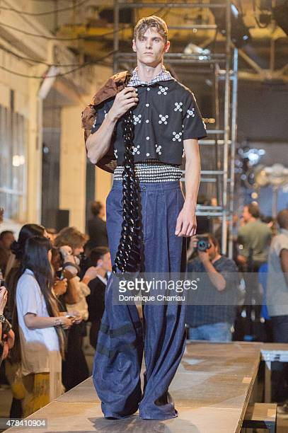 A model walks the runway during the Raf Simons Menswear Spring/Summer 2016 show as part of Paris Fashion Week on June 24 2015 in Paris France