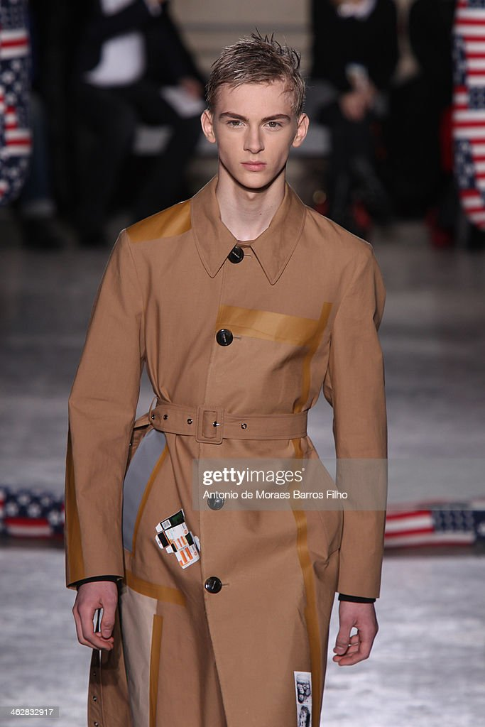 A model walks the runway during the Raf Simons/Sterling Ruby Menswear Fall/Winter 2014-2015 show as part of Paris Fashion Week on January 15, 2014 in Paris, France.
