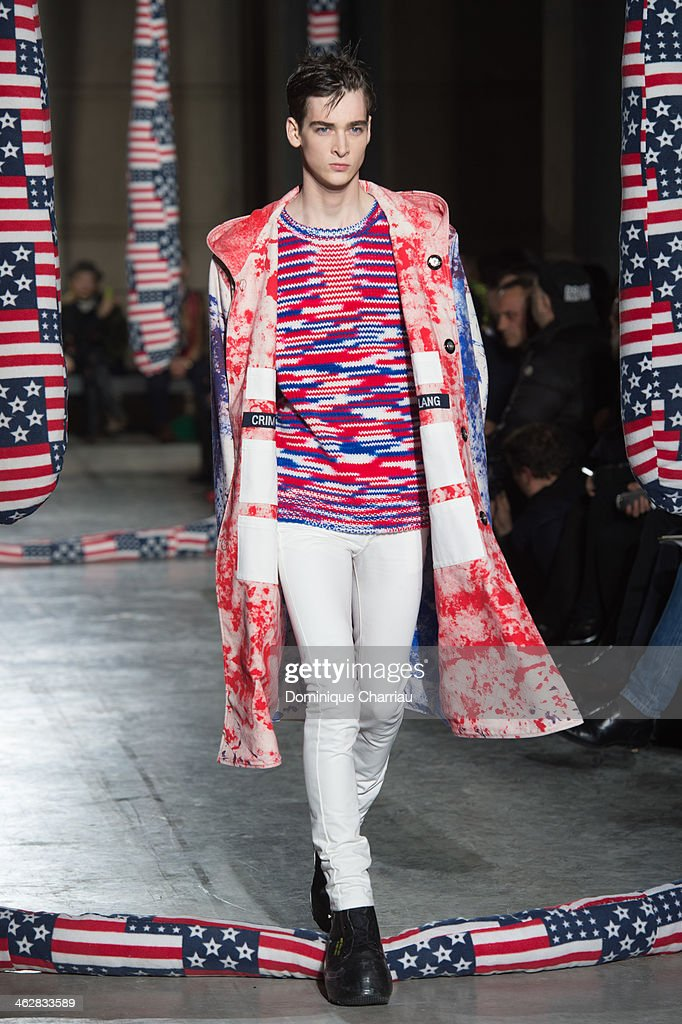 A model walks the runway during the Raf Simons/Sterling Ruby Menswear Fall/Winter 2014-2015 show as part of Paris Fashion Week>> on January 15, 2014 in Paris, France.