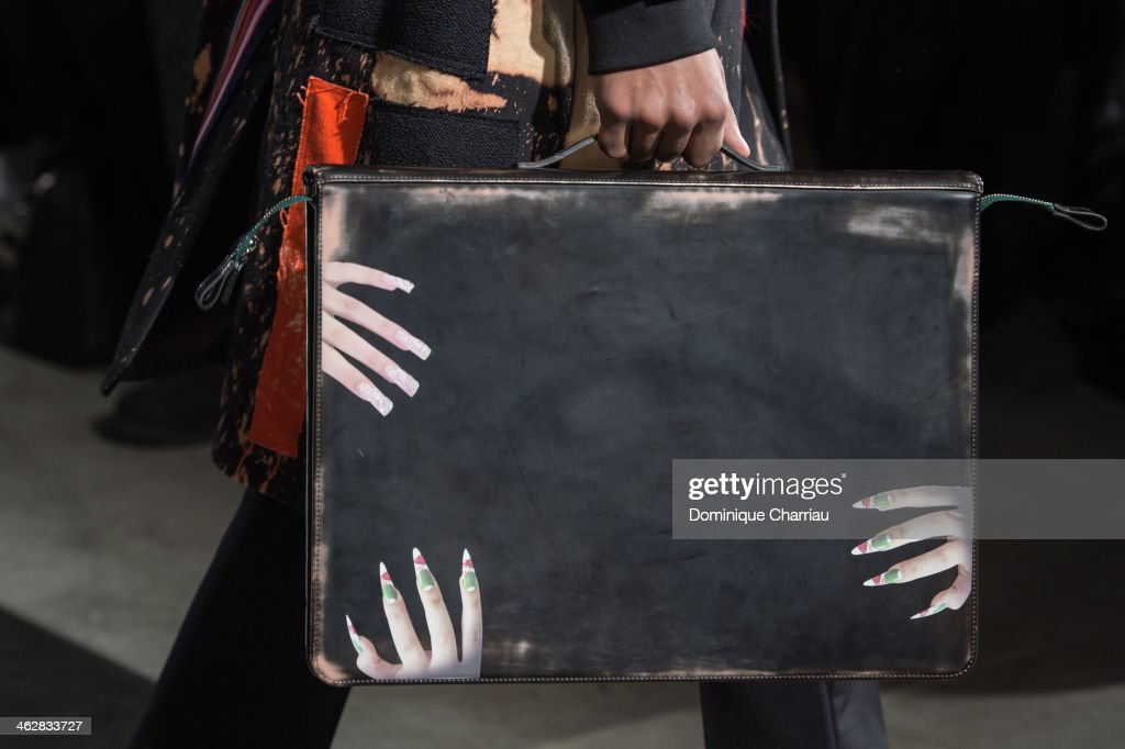A model walks the runway (bag detail) during the Raf Simons/Sterling Ruby Menswear Fall/Winter 2014-2015 show as part of Paris Fashion Week on January 15, 2014 in Paris, France.