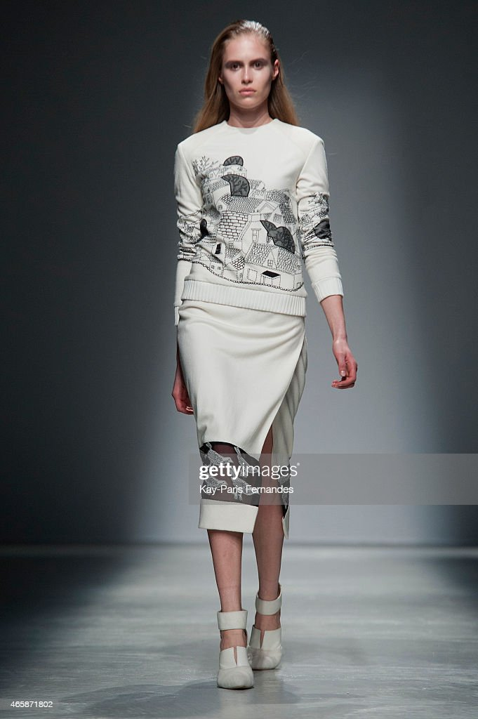 A model walks the runway during the Rahul Mishra show as part of the Paris Fashion Week Womenswear Fall/Winter 2015/2016 on March 11 2015 in Paris...