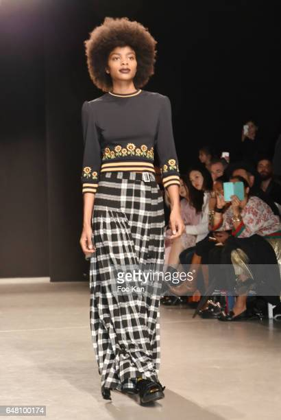 A model walks the runway during the Rahul Mishra show as part of the Paris Fashion Week Womenswear Fall/Winter 2017/2018 at Palais Tokyo on March 4...