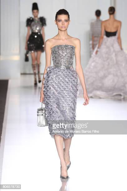 A model walks the runway during the Ralph Russo Haute Couture Fall/Winter 20172018 show as part of Haute Couture Paris Fashion Week on July 3 2017 in...