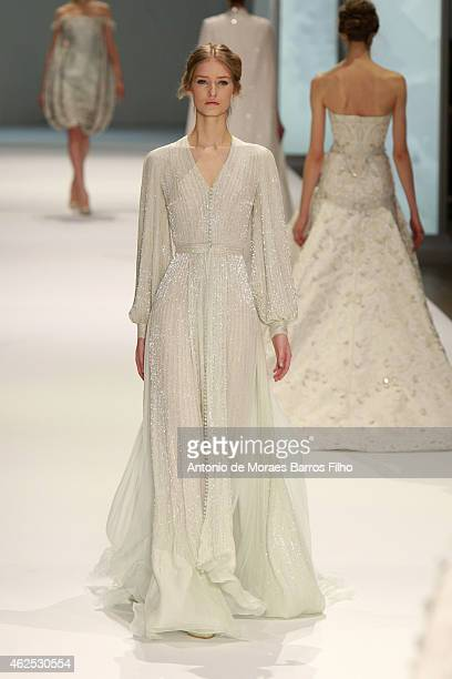 A model walks the runway during the Ralph Russo show as part of Paris Fashion Week Haute Couture Spring/Summer 2015 at Grand Palais on January 29...