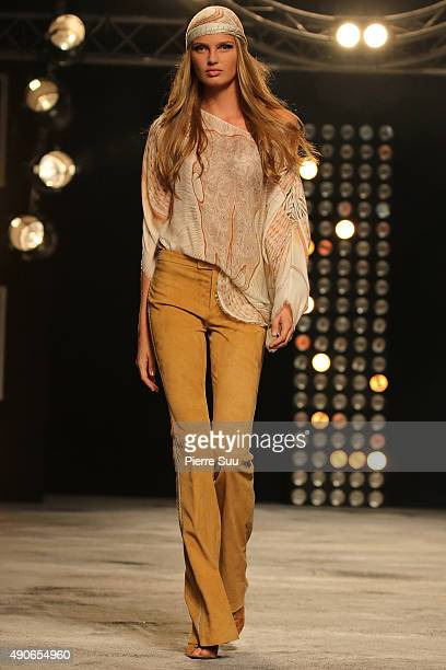 A model walks the runway during the Redemption show as part of the Paris Fashion Week Womenswear Spring/Summer 2016 on September 30 2015 in Paris...