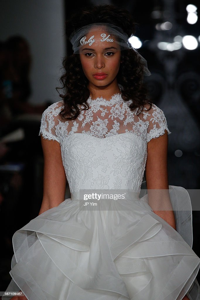 A model walks the runway during the Reem Acra 2014 Bridal Spring/Summer collection show on April 20 2013 in New York City