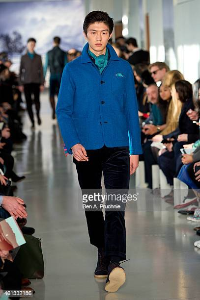 A model walks the runway during the Richard James show at the London Collections Men AW15 at on January 11 2015 in London England