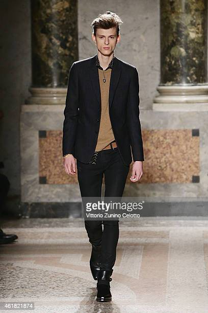 A model walks the runway during the Roberto Cavalli show as a part of Milan Menswear Fashion Week Fall Winter 2015/2016 on January 20 2015 in Milan...