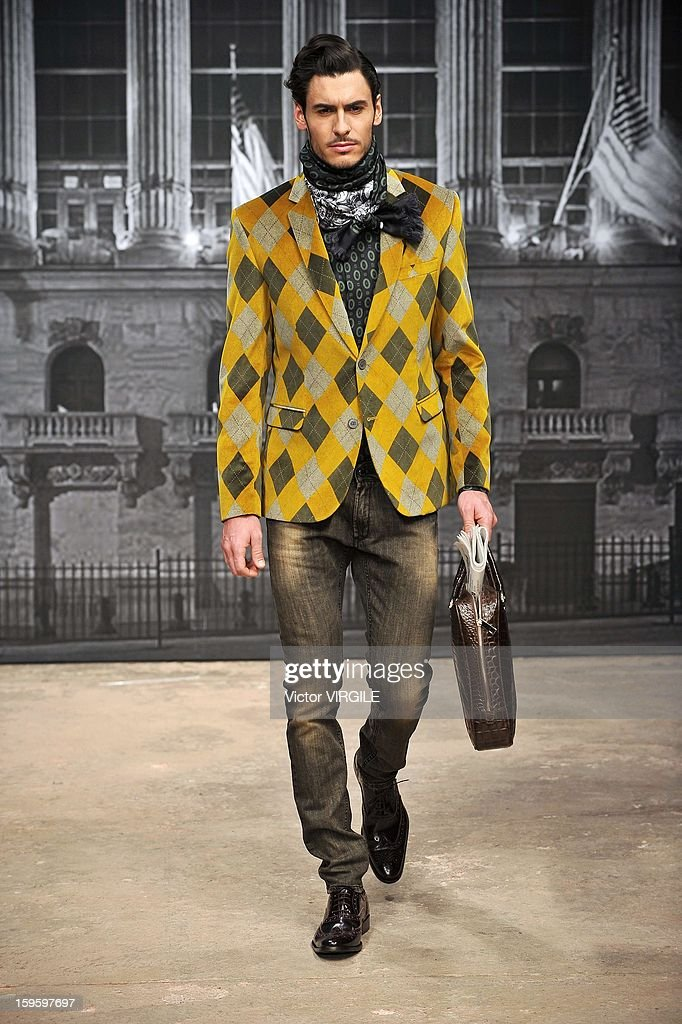 A model walks the runway during the Roccobarocco Ready to Wear Fall/Winter 2013-2014 show as part of Milan Fashion Week Menswear Autumn/Winter 2013 on January 15, 2013 in Milan, Italy.