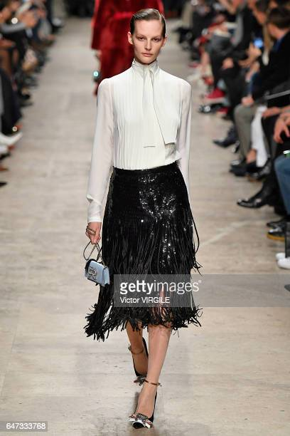 A model walks the runway during the Rochas Ready to Wear fashion show as part of the Paris Fashion Week Womenswear Fall/Winter 2017/2018 on March 1...