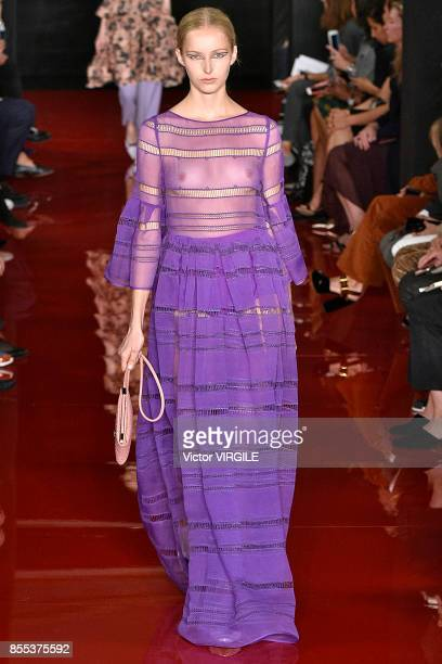 A model walks the runway during the Rochas Ready to Wear Spring/Summer 2018 fashion show as part of the Paris Fashion Week Womenswear Spring/Summer...
