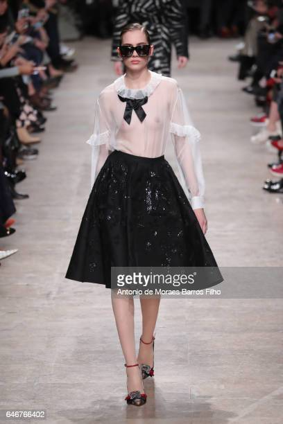 A model walks the runway during the Rochas show as part of the Paris Fashion Week Womenswear Fall/Winter 2017/2018 on March 1 2017 in Paris France
