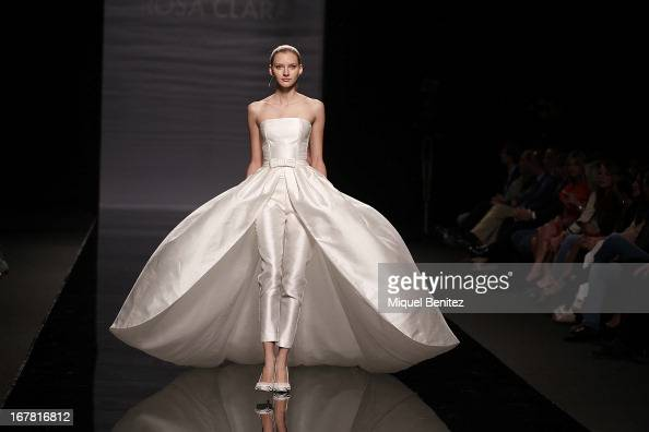 A model walks the runway during the Rosa Clara collection at the Barcelona Bridal Week 2013 on April 30 2013 in Barcelona Spain
