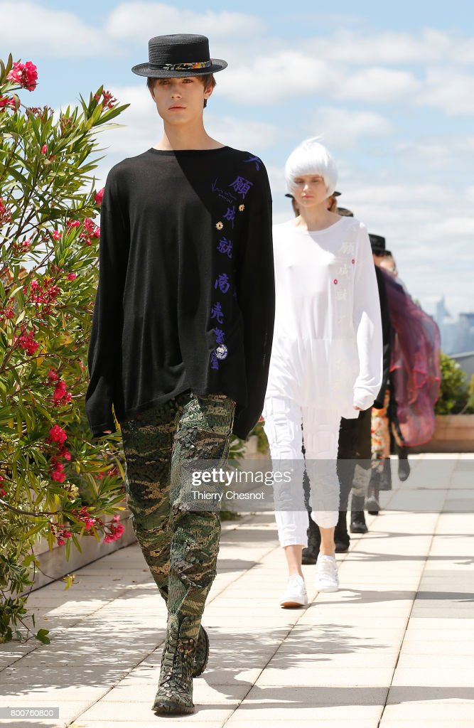 model-walks-the-runway-during-the-rynshu-menswear-springsummer-2018-picture-id800760800