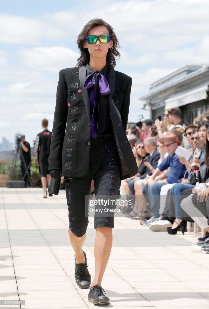 model-walks-the-runway-during-the-rynshu-menswear-springsummer-2018-picture-id800760874