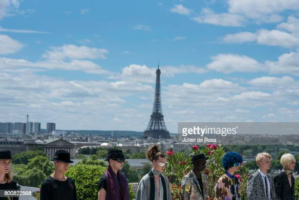 A model walks the runway during the Rynshu Menswear Spring/Summer 2018 show as part of Paris Fashion Week on June 25 2017 in Paris France