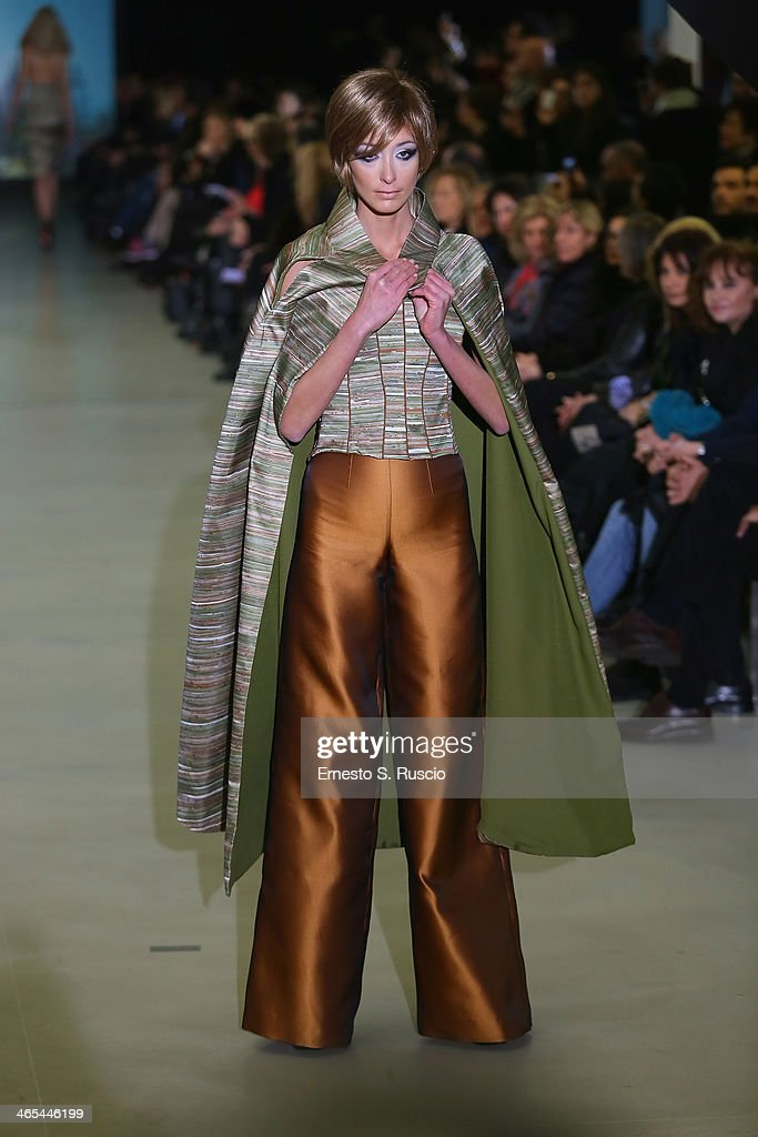 A model walks the runway during the Sabrina Persechino fashion show as part of AltaRoma Fashion Week Spring/Summer 2014 at Santo Spirito in Sassia on January 27, 2014 in Rome, Italy.