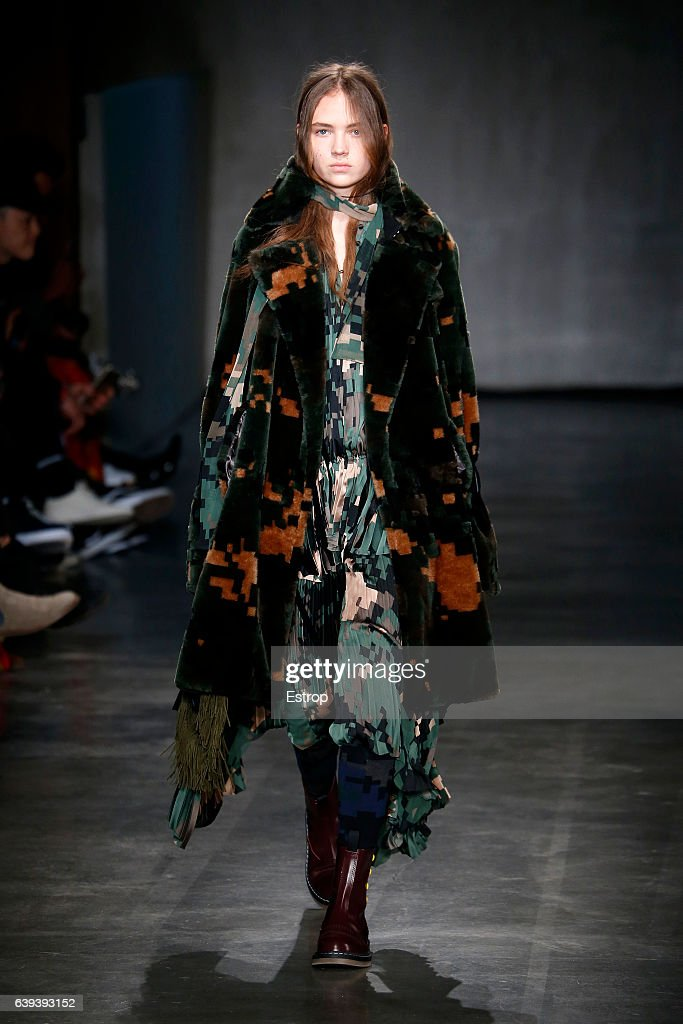 model-walks-the-runway-during-the-sacai-designed-by-chitose-abe-picture-id639393152