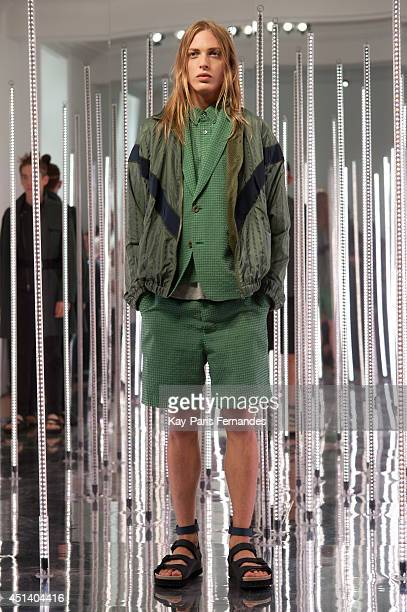 A model walks the runway during the Sacai Man show as part of the Paris Fashion Week Menswear Spring/Summer 2015 on June 28 2014 in Paris France