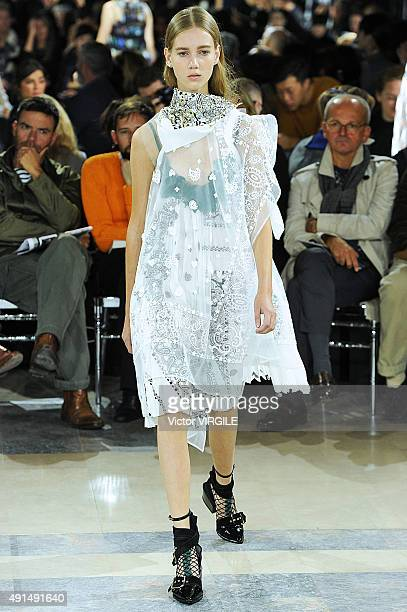 A model walks the runway during the Sacai Ready to Wear show as part of the Paris Fashion Week Womenswear Spring/Summer 2016 on October 5 2015 in...
