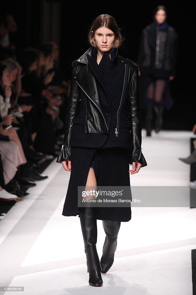 A model walks the runway during the Sacai show as part of the Paris Fashion Week Womenswear Fall/Winter 2014-2015 on March 3, 2014 in Paris, France.