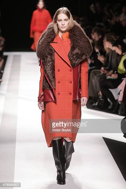 A model walks the runway during the Sacai show as part of the Paris Fashion Week Womenswear Fall/Winter 20142015 on March 3 2014 in Paris France
