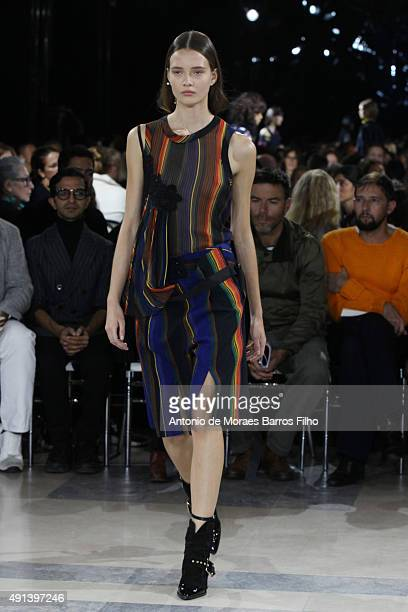 A model walks the runway during the Sacai show as part of the Paris Fashion Week Womenswear Spring/Summer 2016 on October 5 2015 in Paris France