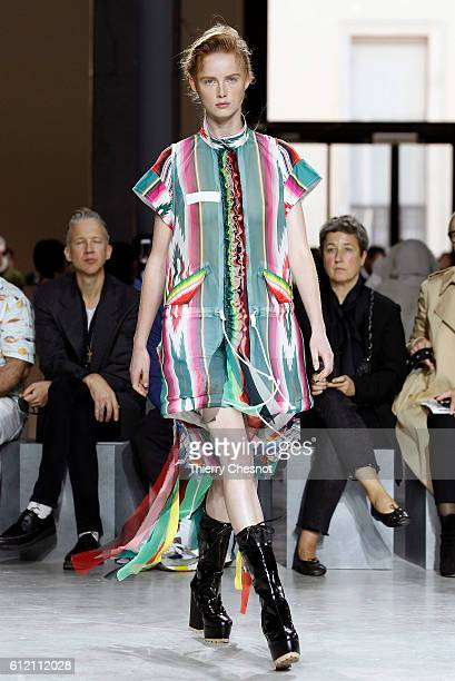 A model walks the runway during the Sacai show as part of the Paris Fashion Week Womenswear Spring/Summer 2017 on October 3 2016 in Paris France