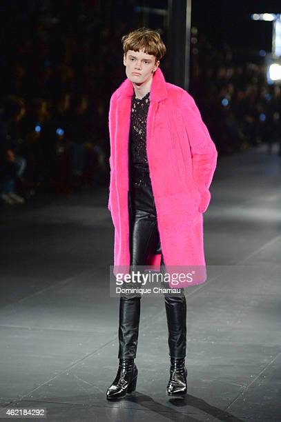 A model walks the runway during the Saint Laurent Menswear Fall/Winter 20152016 show as part of Paris Fashion Week on January 25 2015 in Paris France