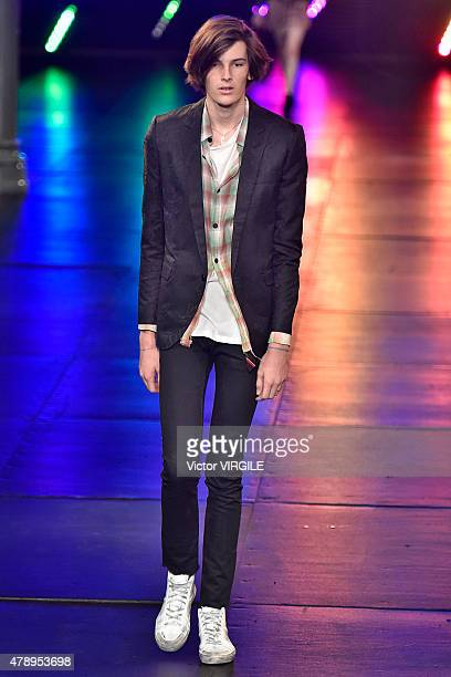A model walks the runway during the Saint Laurent Ready to Wear Menswear Spring/Summer 2016 show as part of Paris Fashion Week on June 28 2015 in...