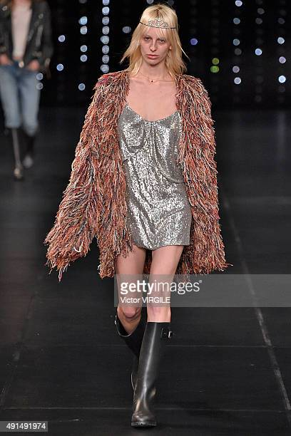 A model walks the runway during the Saint Laurent Ready to Wear show as part of the Paris Fashion Week Womenswear Spring/Summer 2016 on October 5...