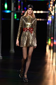 A model walks the runway during the Saint Laurent show as part of the Paris Fashion Week Womenswear Spring/Summer 2015 on September 29 2014 in Paris...