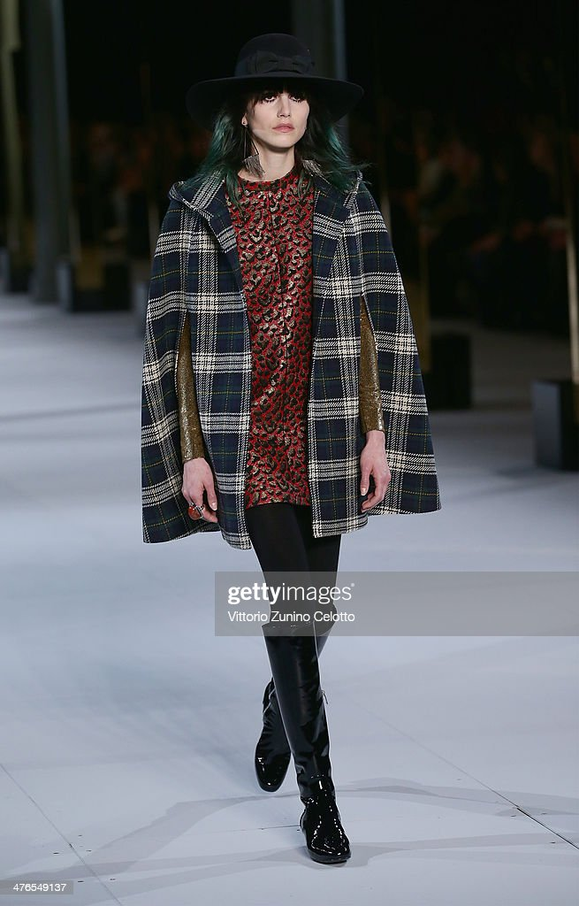 A model walks the runway during the Saint Laurent show as part of the Paris Fashion Week Womenswear Fall/Winter 20142015 at Le Carreau du Temple on...