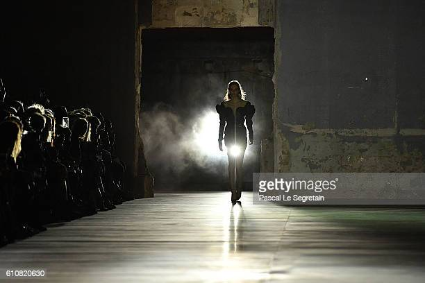 A model walks the runway during the Saint Laurent show as part of the Paris Fashion Week Womenswear Spring/Summer 2017 on September 27 2016 in Paris...