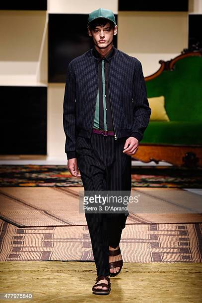 A model walks the runway during the Salvatore Ferragamo fashion show as part of Milan Men's Fashion Week Spring/Summer 2016 on June 21 2015 in Milan...
