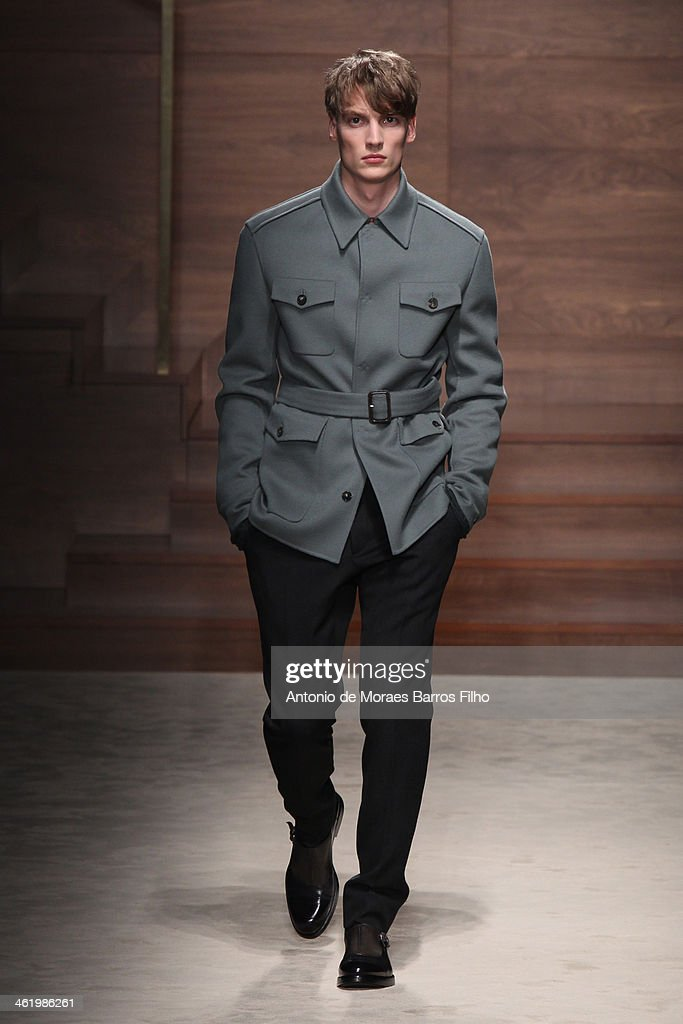 A model walks the runway during the Salvatore Ferragamo show as a part of Milan Fashion Week Menswear Autumn/Winter 2014 on January 12, 2014 in Milan, Italy.