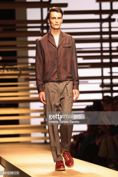A model walks the runway during the Salvatore Ferragamo show as part of Milan Fashion Week Menswear Spring/Summer 2015 on June 22 2014 in Milan Italy