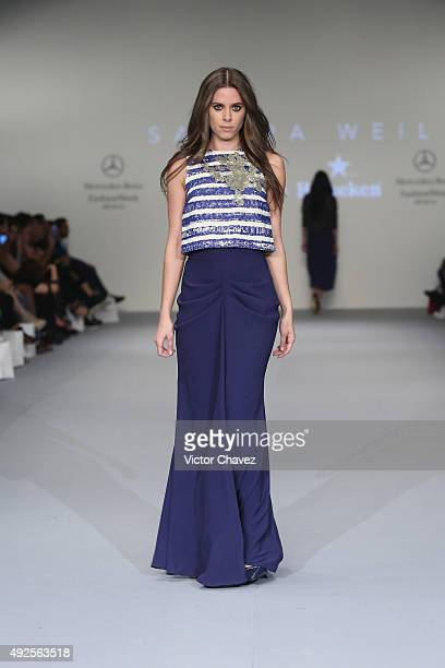 A model walks the runway during the Sandra Weil show at MercedesBenz Fashion Week Mexico Spring/Summer 2016 at Campo Marte on October 13 2015 in...