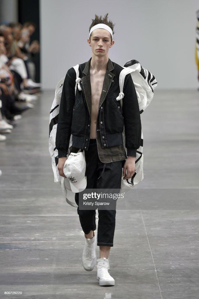 model-walks-the-runway-during-the-sankuanz-menswear-springsummer-2018-picture-id800725220