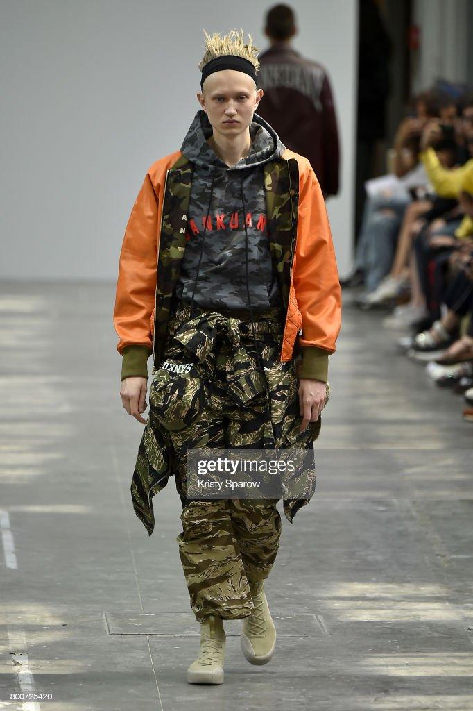 model-walks-the-runway-during-the-sankuanz-menswear-springsummer-2018-picture-id800725420