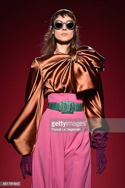A model walks the runway during the Schiaparelli show as part of Paris Fashion Week Haute Couture Fall/Winter 20142015 on July 7 2014 in Paris France