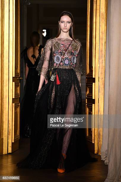 A model walks the runway during the Schiaparelli Spring Summer 2017 show as part of Paris Fashion Week on January 23 2017 in Paris France