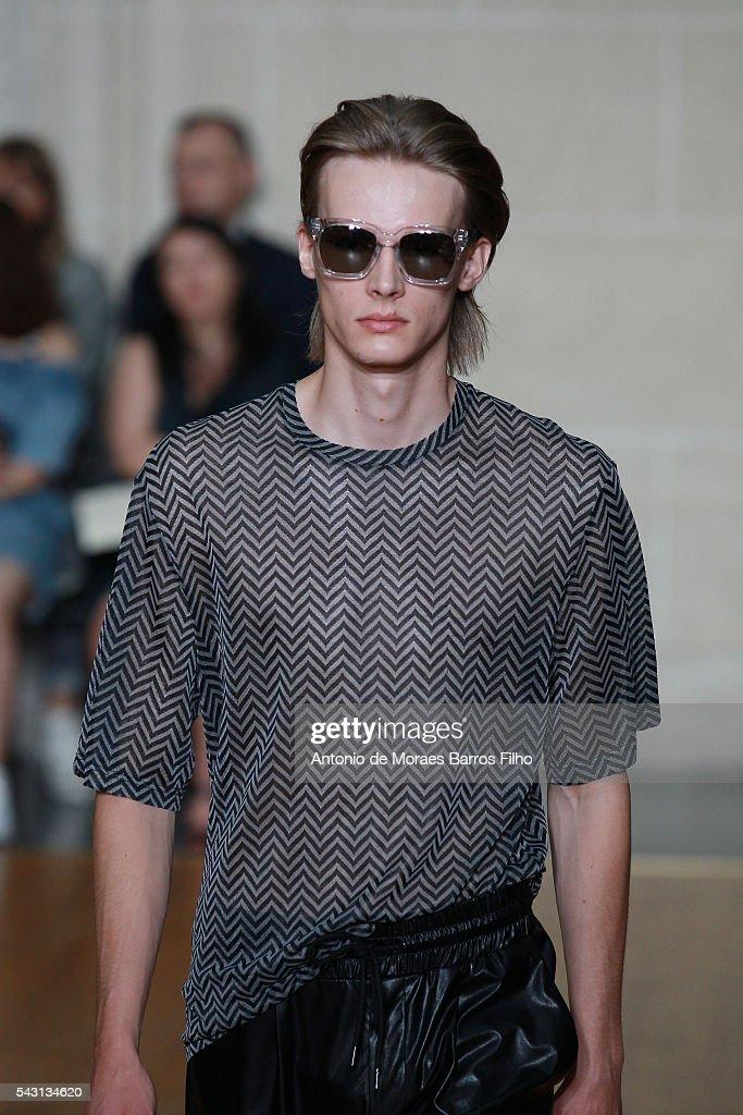A model walks the runway during the Sean Suen Menswear Spring/Summer 2017 show as part of Paris Fashion Week on June 26, 2016 in Paris, France.