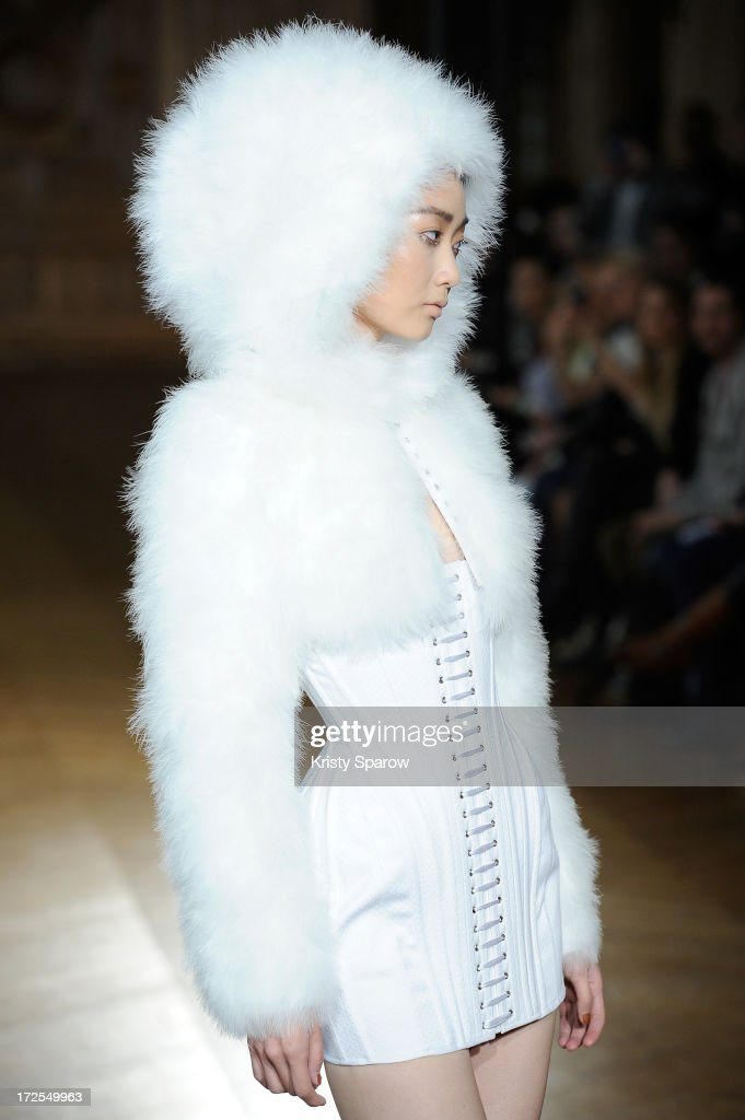 A model walks the runway during the Serkan Cura Couture show as part of Paris Fashion Week Haute-Couture Fall/Winter 2013-2014 at Mairie du 4e on July 3, 2013 in Paris, France.