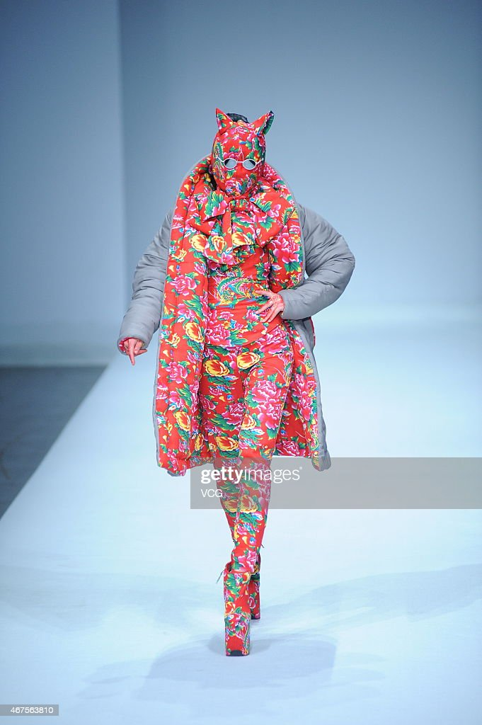 A model walks the runway during the Sheguang Hu show as part of MercedesBenz China Fashion Week 2015/2016 Autumn/Winter Collection at Central Hall on...